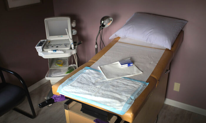 File photo: An ultrasound machine sits next to an exam table in an examination room at abortion provider Whole Woman's Health of South Bend in South Bend, Indiana on June 19, 2019. (Scott Olson/Getty Images)