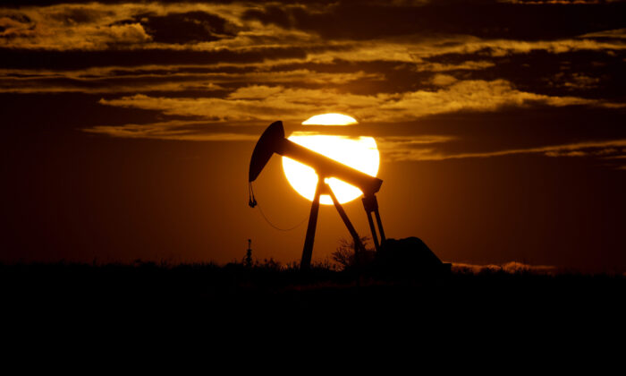 The sun sets behind an idle pump jack near Karnes City, Texas, on April 8, 2020. (Eric Gay/AP Photo)