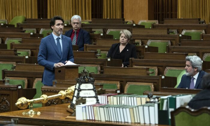 Prime Minister Justin Trudeau rises in the House of Commons on Parliament Hill in Ottawa, as Parliament was recalled for the consideration of measures related to the COVID-19 pandemic, on April 11, 2020. (The Canadian Press/Justin Tang)