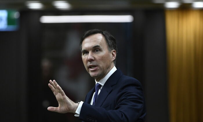 Minister of Finance Bill Morneau rises in the House of Commons on Parliament Hill in Ottawa on April 11, 2020. (The Canadian Press/Justin Tang)