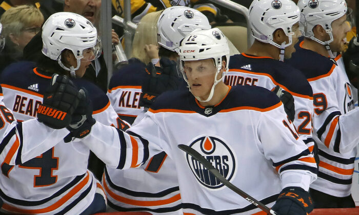 Edmonton Oilers' Colby Cave returns to the bench after scoring during the second period of an NHL hockey game against the Pittsburgh Penguins in Pittsburgh on Nov. 2, 2019. (Gene J. Puskar/AP Photo)