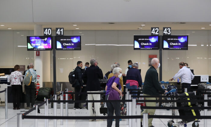New Zealand passengers from the Vasco Da Gama cruise ship check in for their Air New Zealand flight to Auckland at Perth International Airport on March 28, 2020. (Paul Kane/Getty Images)