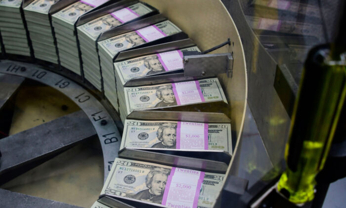 Packs of freshly printed 20 USD notes are processed for bundling and packaging at the US Treasury's Bureau of Engraving and Printing in DC on July 20, 2018.  (Eva Hambach/AFP via Getty Images)