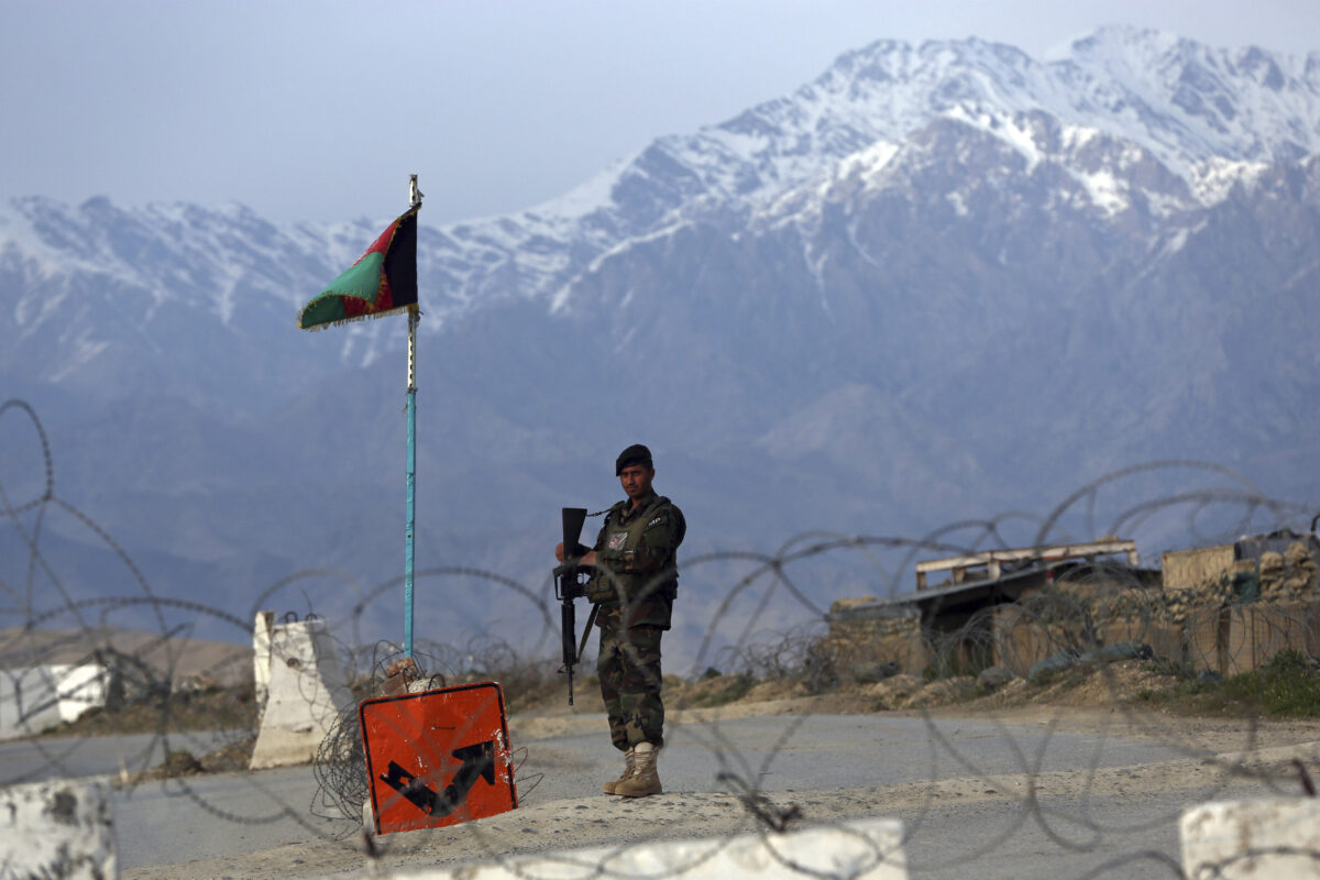 An Afghan National Army soldier stands guard