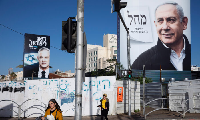 Election campaign billboards showing Israeli Prime Minister Benjamin Netanyahu (R) and Benny Gantz (L) in Bnei Brak, Israel, on March 1, 2020. (Oded Balilty/AP Photo)