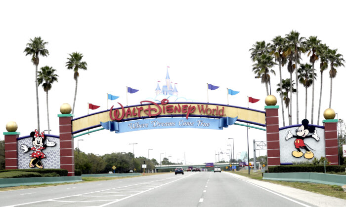 The road to the entrance of Walt Disney World in Lake Buena Vista, Fla., on March 16, 2020. (John Raoux/AP Photo)