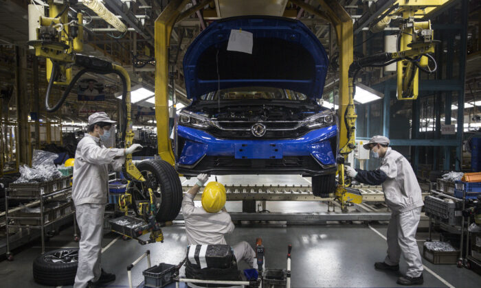 An employee works on the assembly line at the Dongfeng Fengshen plant in Wuhan, Hubei Province, China, on on March 24, 2020. (Getty Images)