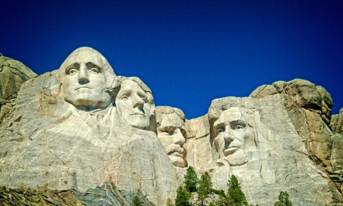 """Mount Rushmore National Memorial is the greatest work of American sculptor Gutzon Borglum, who thought of it as """"the formal rendering of the philosophy of our government into granite on a mountain peak."""" (Copyright Fred J. Eckert)"""