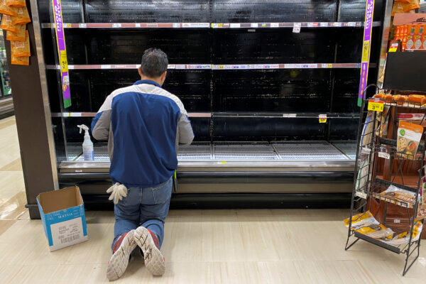 A-store-worker-cleans-an-empty-display-for-eggs
