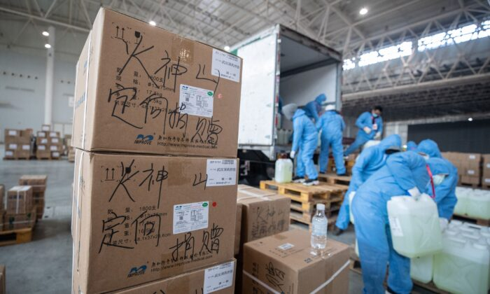 Workers transfer medical supplies at a warehouse in Wuhan, China, on Feb. 4, 2020. (STR/AFP via Getty Images)