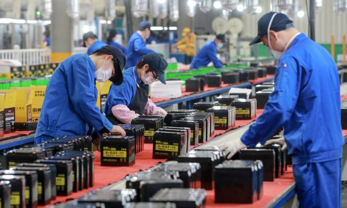 Employees are working on a battery production line at a factory in Huaibei in China's eastern Anhui Province on March 30, 2020. (STR/AFP via Getty Images)