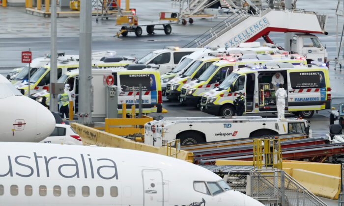 MELBOURNE, AUSTRALIA - APRIL 12: Ambulances are seen on the tarmac at Melbourne airport on April 12, 2020 in Melbourne, Australia. Over 1000 passengers arriving from Peru, Uruguay and India. (Photo by Darrian Traynor/Getty Images)