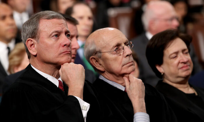 U.S. Supreme Court Chief Justice John G. Roberts (L-R),  Associate Justice Stephen G. Breyer, and Associate Justice Elena Kagan listen to President Trump's State of the Union address in the chamber of the U.S. House of Representatives in Washington, on Jan. 30, 2018. (Win McNamee/Getty Images)