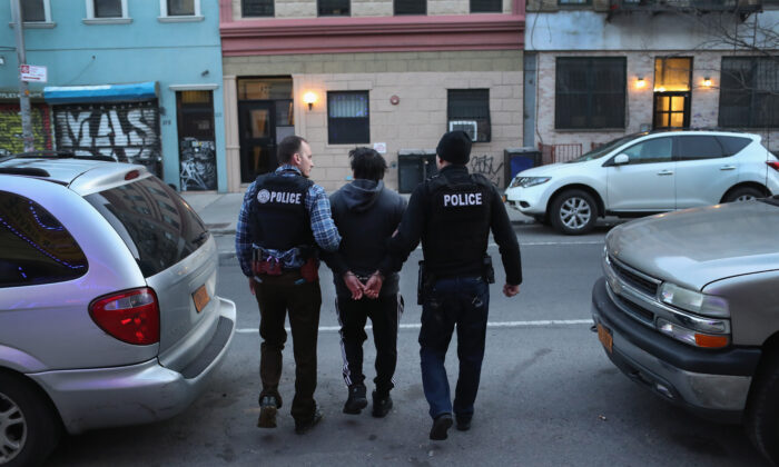 Immigration and Customs Enforcement (ICE) officers arrest an undocumented Mexican immigrant during a raid in the Bushwick neighborhood of Brooklyn on April 11, 2018. (John Moore/Getty Images)