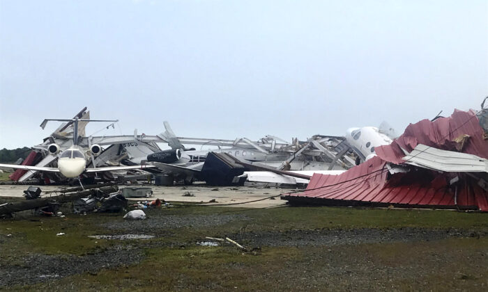 A destroyed hangar and damaged planes are seen at Monroe Regional Airport in Monroe, La., on April 12, 2020. (Monroe News Star/Greg Hilburn via AP)