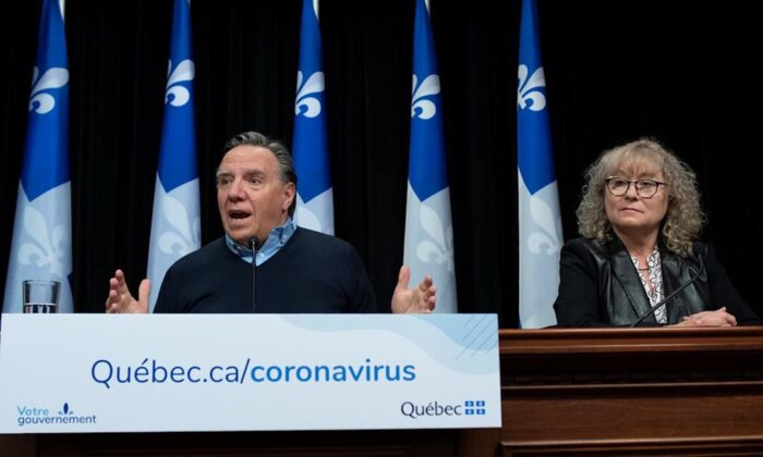 Quebec Premier Francois Legault responds to reporters during a news conference on the COVID-19 pandemic at the legislature in Quebec City on April 13, 2020. (Jacques Boissinot/The Canadian Press)