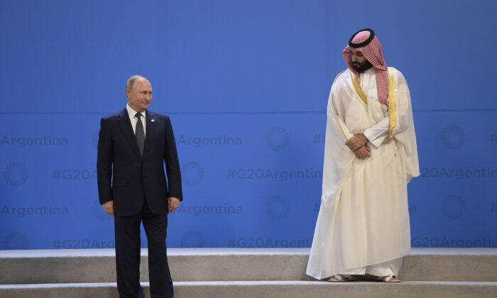 Russia's President Vladimir Putin and Saudi Arabia's Crown Prince Mohammed bin Salman line up for a group photo, during the G-20 Leaders' Summit in Buenos Aires, on Nov. 30, 2018. (JUAN MABROMATA/AFP via Getty Images)