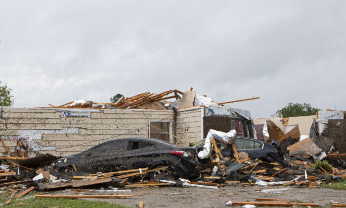 A home had its roof torn off after a tornado ripped through Monroe, La., just before noon on  April 12, 2020. (Nicolas Galindo/The News-Star via AP)