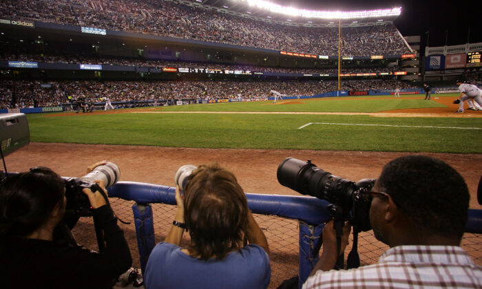 Photographers cover the game between the New York Yankees and the Chicago White Sox at Yankee Stadium in the Bronx borough of New York City on Sept. 17, 2008. (Jim McIsaac/Getty Images)