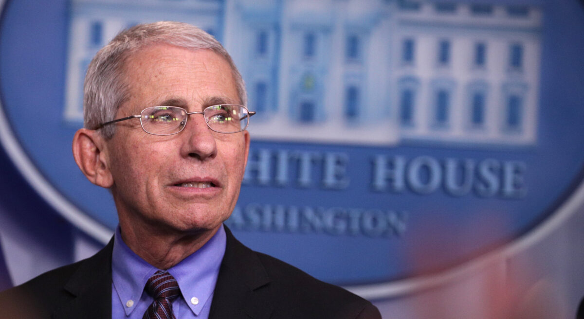 Anthony Fauci listens during the daily coronavirus briefing