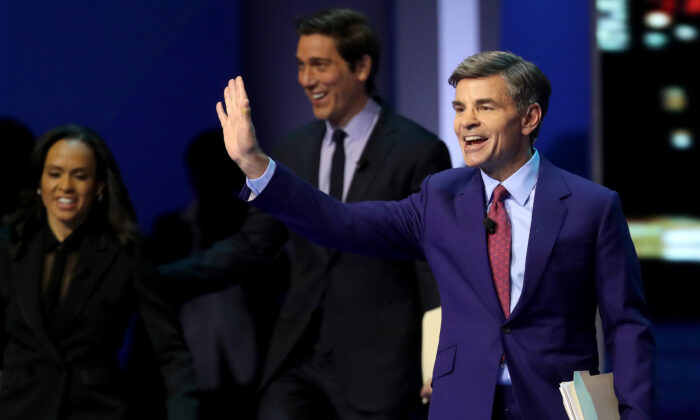 George Stephanopoulos (R) arrives at the Democratic presidential primary debate in the Sullivan Arena at St. Anselm College in Manchester, N.H., on Feb. 7, 2020. (Win McNamee/Getty Images)