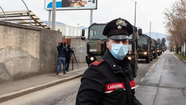 A Carabinieri officer blocks the road