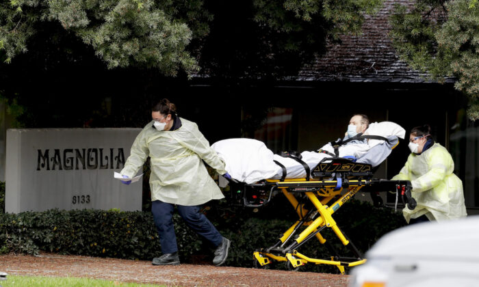 A patient is evacuated from the Magnolia Rehabilitation and Nursing Center in Riverside, Calif., on April 8, 2020. (Chris Carlson/AP)