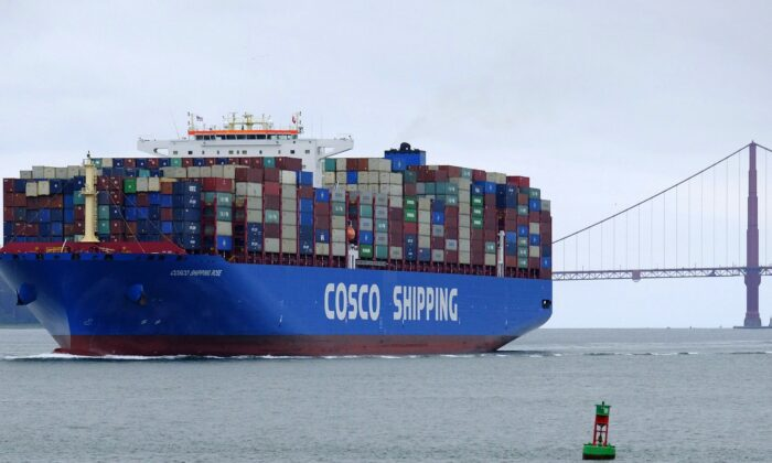 A China Ocean Shipping Company container ship passes the Golden Gate Bridge in San Francisco on May 14, 2019, bound for the Port of Oakland. (AP Photo/Eric Risberg)