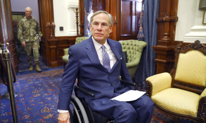 Texas Governor Greg Abbott arrives for his COVID-19 press conference at the Texas State Capitol in Austin on March 29, 2020. (Tom Fox-Pool/Getty Images)