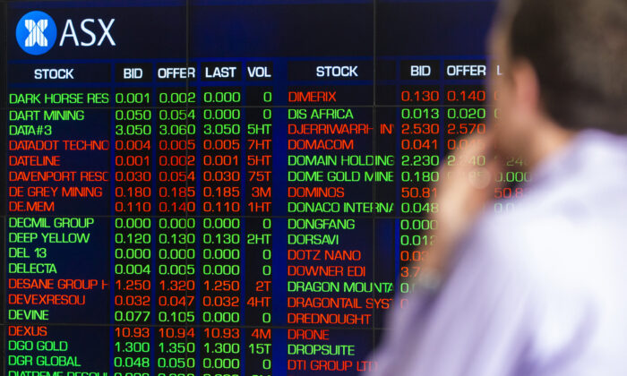 SYDNEY, AUSTRALIA - MARCH 13: A man looks at the electronic display of stocks at the Australian Stock Exchange on March 13, 2020 in Sydney, Australia. (Photo by Jenny Evans/Getty Images)