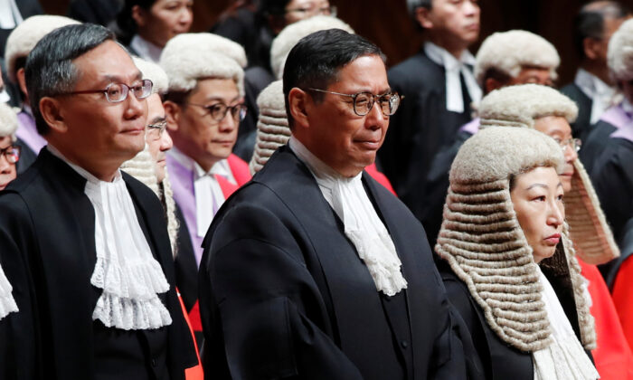 (L-R) Judges of the Court of Final Appeal Andrew Cheung Kui-nung, Robert Ribeiro and Secretary of Justice Teresa Cheng attend a ceremony to mark the beginning of the legal year in Hong Kong, China, on Jan. 14, 2019. (Tyrone Siu/Reuters)