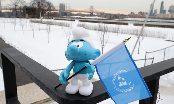 A Smuf holding a UN flag at the United Nations Headquarters celebrating International Day of Happiness in conjunction with SMURFS: THE LOST VILLAGE in New York City on March 18, 2017. (Cindy Ord/Getty Images for Sony Pictures)