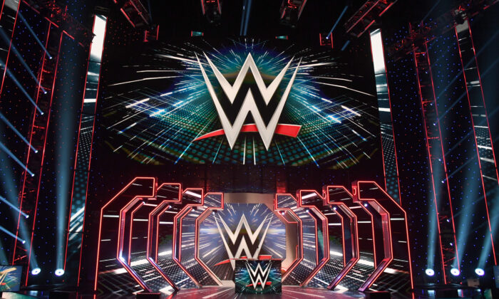 WWE logos are shown on screens before a WWE news conference at T-Mobile Arena on Oct. 11, 2019 in Las Vegas, Nev. (Ethan Miller/Getty Images)