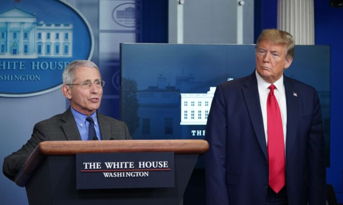 Director of the National Institute of Allergy and Infectious Diseases Anthony Fauci speaks as President Donald Trump listens, at the White House on April 13, 2020. (Mandel Ngan/AFP via Getty Images)