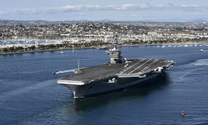 In this handout released by the U.S. Navy, the aircraft carrier USS Theodore Roosevelt leaves its San Diego homeport on Jan. 17, 2020. (U.S. Navy via Getty Images)