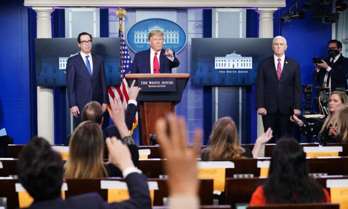 President Donald Trump, center, speaks to reporters in the White House in Washington on April 13, 2020. (Mandel Ngan/AFP via Getty Images)