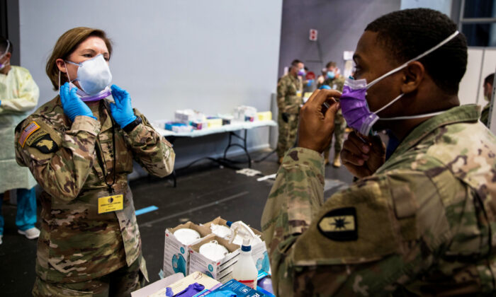 Army Lieutentant General Laura Richardson, commanding general of U.S. Army North, puts on personal protective equipment before entering the patient care area at Javits New York Medical Station, which is supporting local hospitals treating coronavirus disease (COVID-19) in New York City, on April 12, 2020. (U.S. Navy/Chief Mass Communication Specialist Barry Riley/Handout via Reuters)