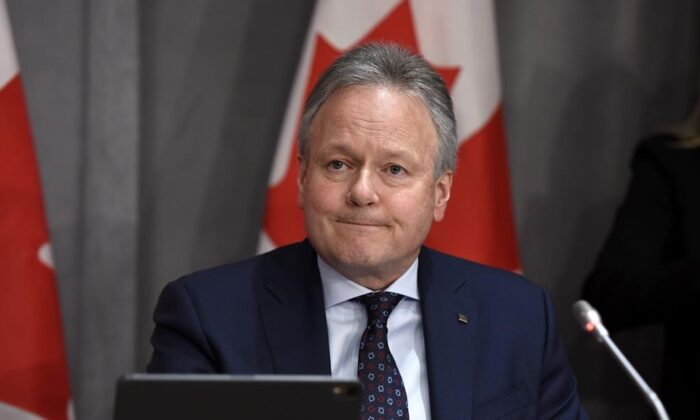 Governor of the Bank of Canada Stephen Poloz listens to a question at a press conference on Parliament Hill in Ottawa, on Wednesday, March 18, 2020. Canada's central bank will make an announcement today on its key interest rate and detail the impact of COVID-19 on the national economy. (Justin Tang/The Canadian Press)