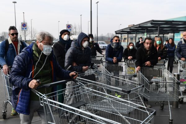 Residents wait to be given access to shop