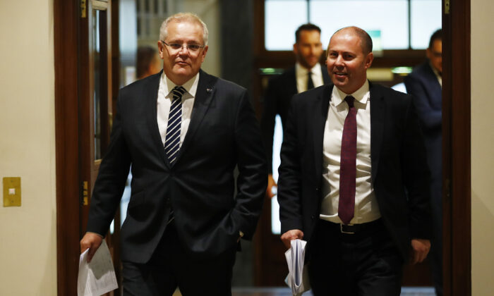 (L-R) Prime Minister Scott Morrison and Treasurer Josh Frydenberg before a press conference on Dec. 12, 2019 in Melbourne, Australia. (Daniel Pockett/Getty Images)