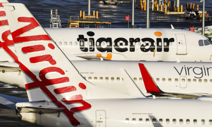 Tiger Air and Virgin sit idle on the tarmac at Melbourne's Tullamarine Airport on April 12, 2020. (William West/AFP via Getty Images)
