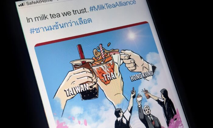 "A mobile phone displays an internet meme of a growing online movement called ""Milk Tea Alliance"" to show solidarity between Thailand, Taiwan and Hong Kong, in this illustration taken on April 15, 2020. (Patpicha Tanakasempipat/Illustration/Reuters)"