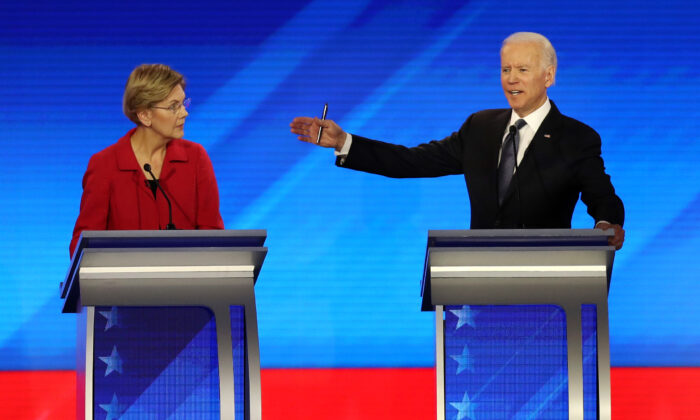 Democratic presidential candidates Sen. Elizabeth Warren (D-MA) and former Vice President Joe Biden participate in a primary debate in New Hampshire on Feb. 7, 2020. (Joe Raedle/Getty Images)