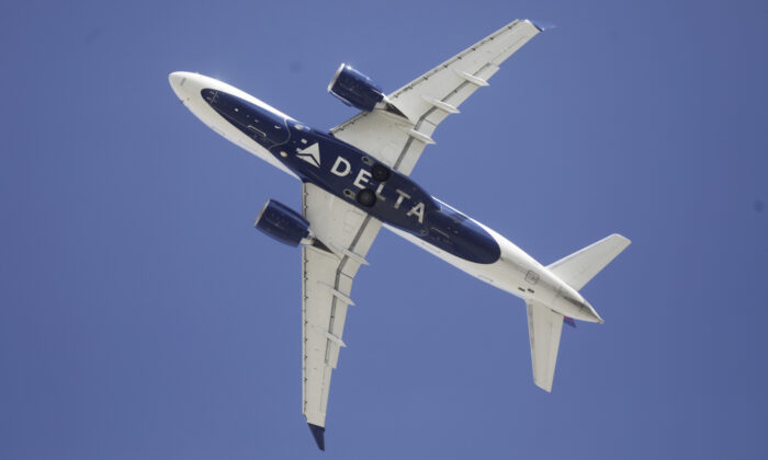 Delta flight is shown taking off from Salt Lake City International Airport, in Salt Lake City on April 7, 2020. (Rick Bowmer/AP)