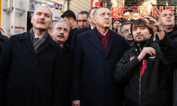 Turkish President Recep Tayyip Erdogan, Interior minister Suleyman Soylu (L) and head of Turkish Parliament Mustafa Sentop (2nd L) visits the earthquake site on Jan. 25, 2020 in Elazig, Turkey. (Burak Kara/Getty Images)
