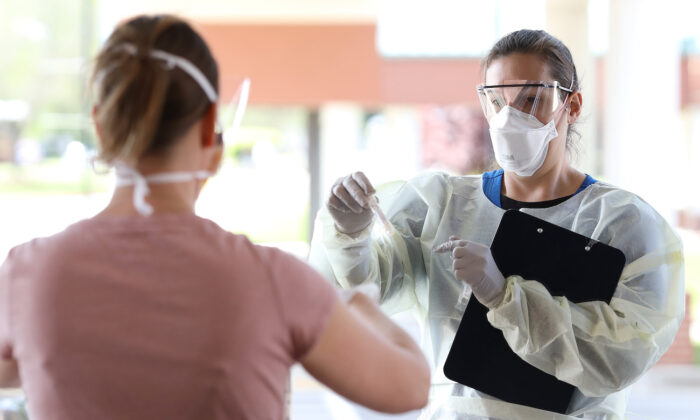 A nurse administers COVID-19 testing at a drive-up facility at MedStar St. Mary's Hospital in Leonardtown, Maryland on April 14, 2020. (Win McNamee/Getty Images)