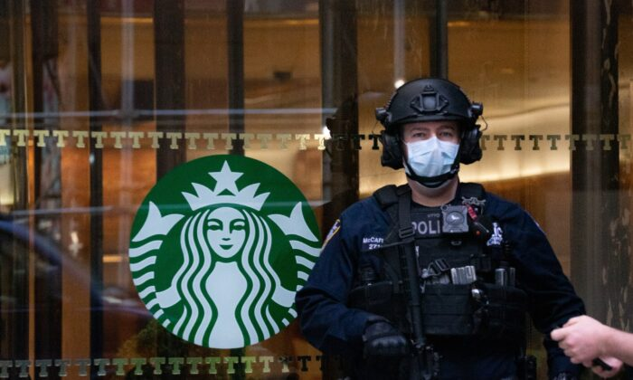 A police officer wearing a mask stands watch at Trump Tower in New York City on April 14, 2020. (David Dee Delgado/Getty Images)