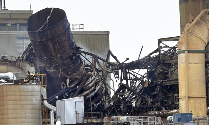 Wreckage smolders at the Androscoggin Mill after an explosion at the paper mill in Jay, Maine, on April 15, 2020. (Robert F. Bukaty/AP Photo)