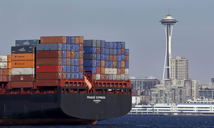 The Prague Express container ship is anchored in Elliott Bay near downtown Seattle in a file photo. (AP Photo/Elaine Thompson, File)