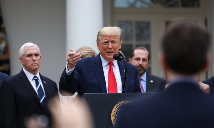 President Donald Trump, flanked by officials and business leaders, announces a national emergency with regard to the coronavirus in the White House Rose Garden in Washington on March 13, 2020. (Charlotte Cuthbertson/The Epoch Times)